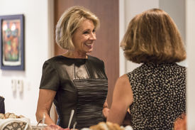 Betsy DeVos smiles during an art event