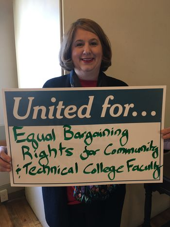 Carla holds a sign for equal bargaining rights for community and technical college faculty