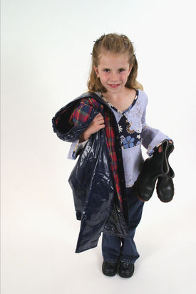 A student holds a new raincoat.