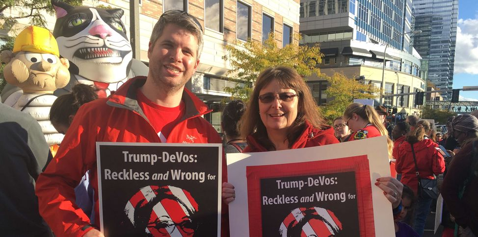 Educators with Reckless Wrong DeVos sign
