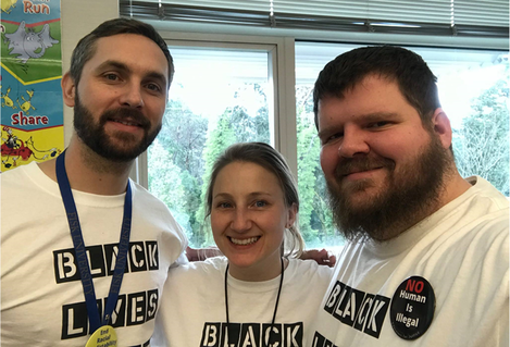 Luke Michener and Terry Jess posse with a colleague wearing Black Lives Matter shirts.