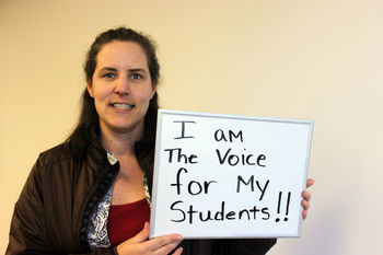 Educator with sign - I am the voice for my students